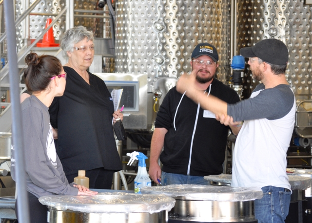Dr. Hildegarde Heymann, second from left, consults with students in the Winemaking lab class.