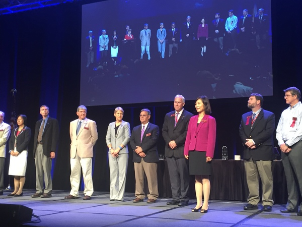 BAEs own Dr. Ruihong Zhang (third from right) steps forward as shes inducted as a Fellow of ASABE.