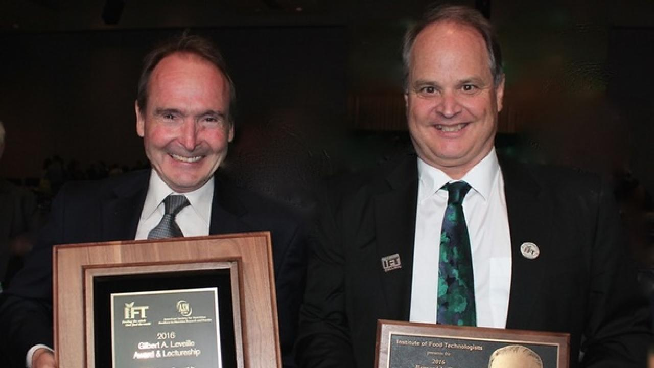 Bruce German and Carl Winter with their awards