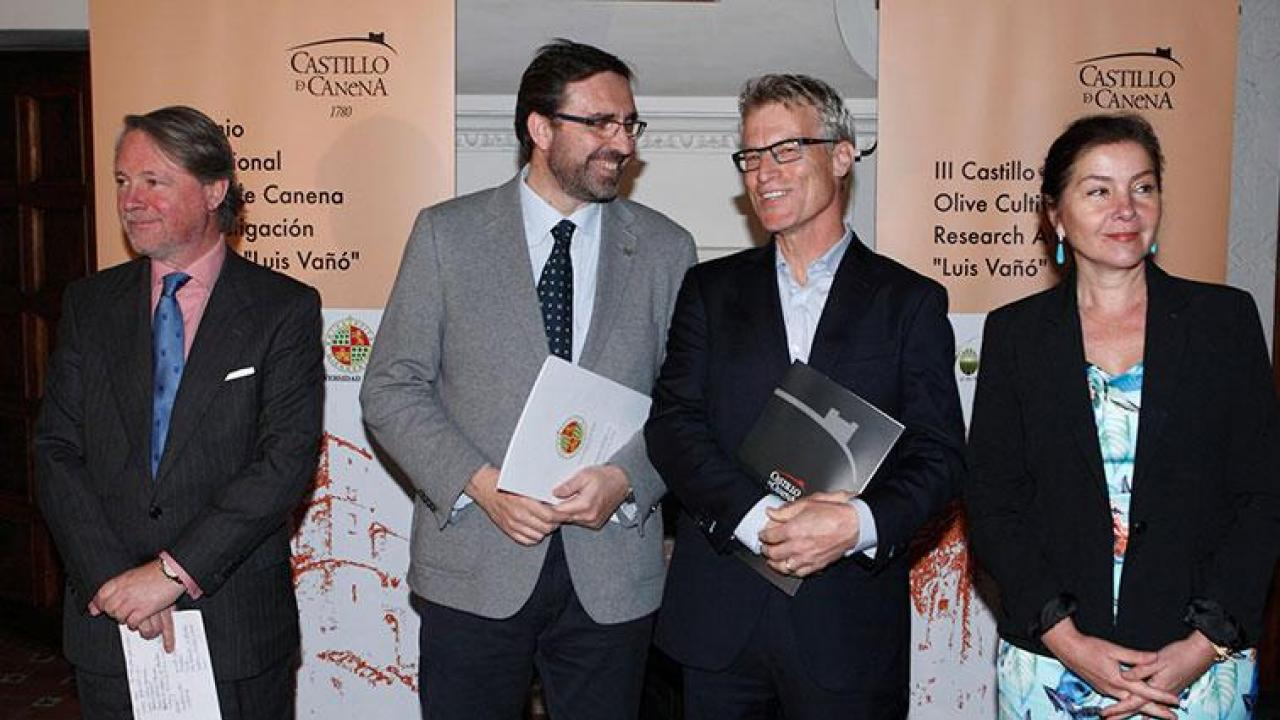 The UC Davis Olive Center's Dan Flynn, second from right, stands alongside Juan Gómez, rector of the University of Jaén, during the award ceremony in Castillo de Canena, the castle after which the olive oil company is named