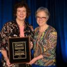 Dr. Bruhn receives her award from IAFP President Dr. Linda Harris, who is also the FST Chair